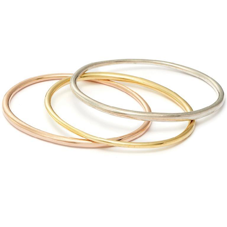 Modern 14 Karat Rose Gold Elliptical Bangle For Sale
