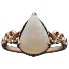 14 Karat Rose Gold Ethiopian Opal and Diamonds Ring