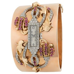 14 Karat Rose Gold, Ruby and Diamond Watch Bangle