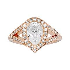 14 Karat Rose Gold Split Shank Pear Cut Moissanite and Diamond Engagement Ring