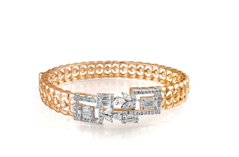 Diamond: 1.99 carats  Gold: 18.760 grams 14 k Colour: HI Clarity: SI Note: This piece is available on order  This timeless bracelet sits perfectly on your wrist adding the perfect touch of glamour and sparkle