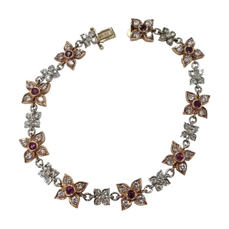 14 Karat Rose-White Gold Ruby and Diamond Floral Bracelet For Sale