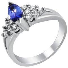 14 Karat Tanzanite and Diamond Cluster Ring