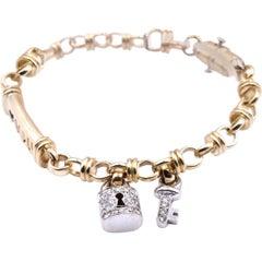 14 Karat Two-Tone Bracelet with Diamond Key and Lock Charms