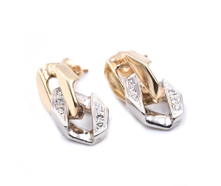 Material: 14k white and yellow gold Diamonds: 12 round brilliant cuts = .12cttw Color: G Clarity: SI1 Dimensions: earrings measure 24.5mm x 10.3mm Fastenings: screw backs Weight: 9.18 grams