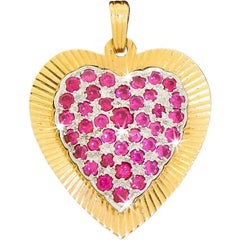 14 Karat Two-Tone Gold Love Heart Pendant For Necklace With Red Ruby Gemstones