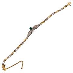 14 Karat Two-Toned Emerald Fancy Link Bracelet .66 Total Diamond Weight
