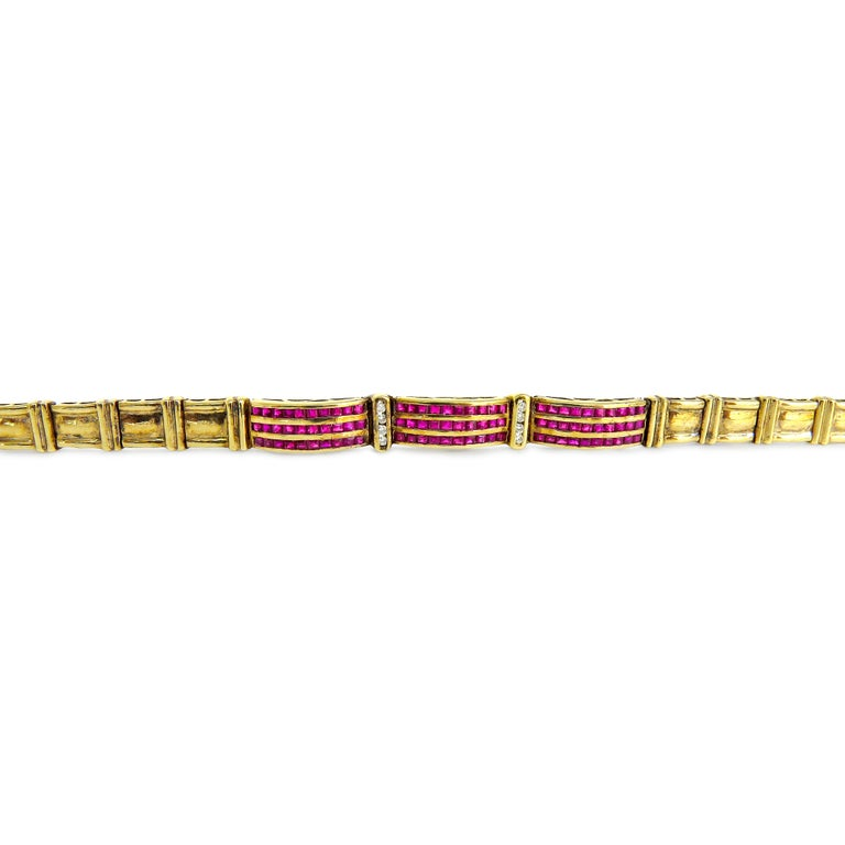 14K Yellow Gold  Weight= 16.2gr  Length= 8 Inches   Diamond= 0.08 Ct total  Ruby= 0.90 Ct total  Year= 2000