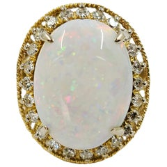14 Karat Vintage Oval Opal and Diamond Halo Cocktail Ring