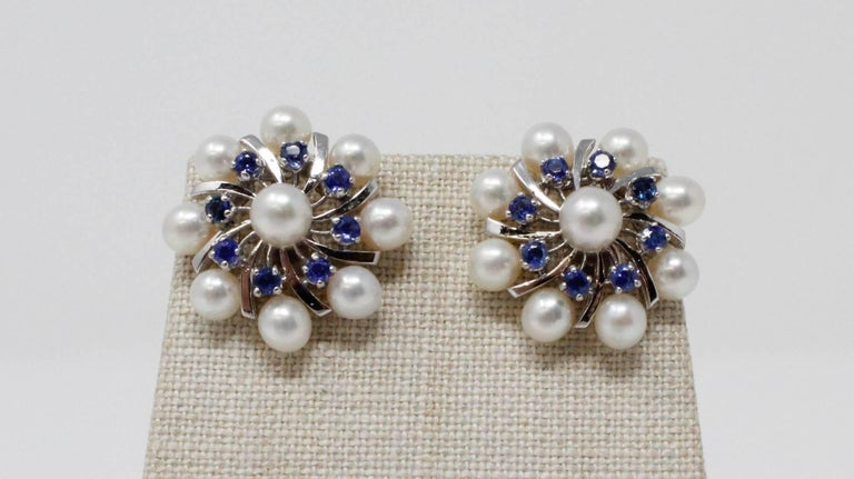 Pearl and sapphire clip earrings set in 14 karat white gold. The sapphires weigh approximately 1.28 carats.