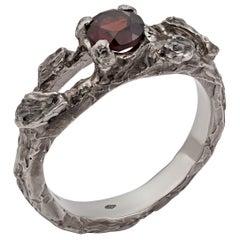 "14 Karat White Aged Gold Ring ""Embrace"" with Garnet"
