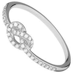 14 Karat White Gold 0.107 Carat Knot Round Diamond Ring