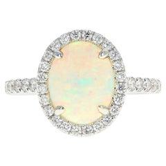 14 Karat White Gold 1.29 Carat Oval Cut Opal and Diamond Ring