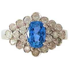 14 Karat White Gold 1.35 Carat Blue Sapphire and .80 Carat Diamond Ring
