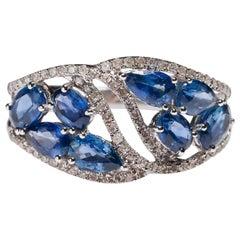 14 Karat White Gold 2.24 Carat Oval Blue Sapphire 0.22 Carat Diamond Band Ring