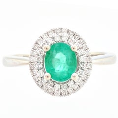 14 Karat White Gold .66 Carat Emerald and Diamond Double Halo Ring