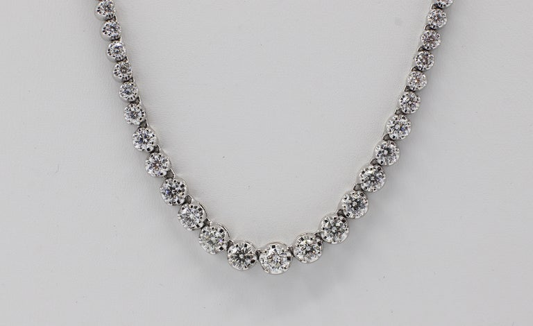 14 Karat White Gold Diamond Riviera Graduated Necklace  Metal: 14k white gold Weight: 21 grams Diamonds: 117 round brilliant cut diamonds, approx. 7 CTW G VS-SI. Diamonds range from .01cts to .25ct Length: 17 inches