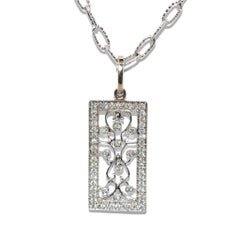 14 Karat White Gold and 0.60 Carat Diamond Vintage Pendant 3.90 Grams