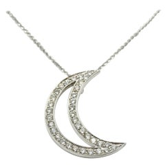 14 Karat White Gold and 0.70 Carat Diamond Crescent Moon Pendant
