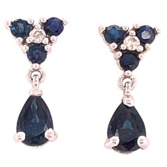 14 Karat White Gold and Blue Sapphire Drop Earrings 0.02 Total Diamond Weight