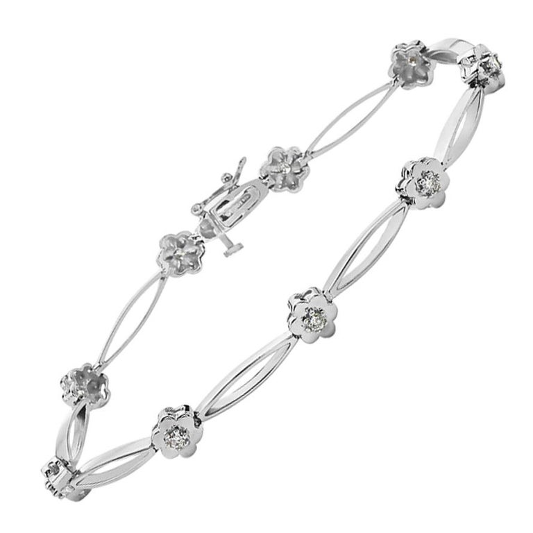 14 Karat White Gold and Diamond Flower Bracelet For Sale