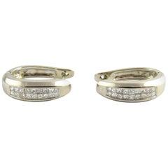 14 Karat White Gold and Diamond Oval Hoop Earrings