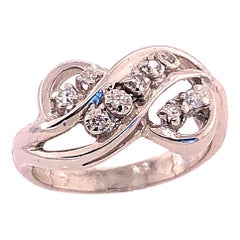 14 Karat White Gold and Diamond Swirl Ring