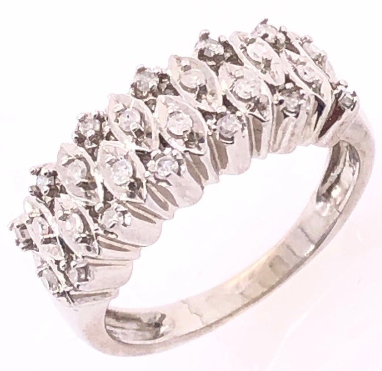 14 Karat White Gold Contemporary Ring with Diamonds. 0.72 total diamond weight. Size 5.75 4 grams total weight.