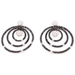 14 Karat White Gold Black and White Diamond Circular Earrings