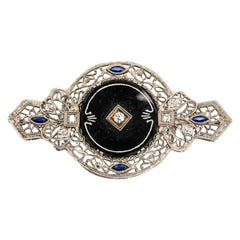14 Karat White Gold Black Onyx, Diamond and Synthetic Blue Sapphire Brooch