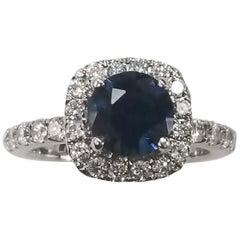 14 Karat White Gold Blue Sapphire and Diamond Halo Ring
