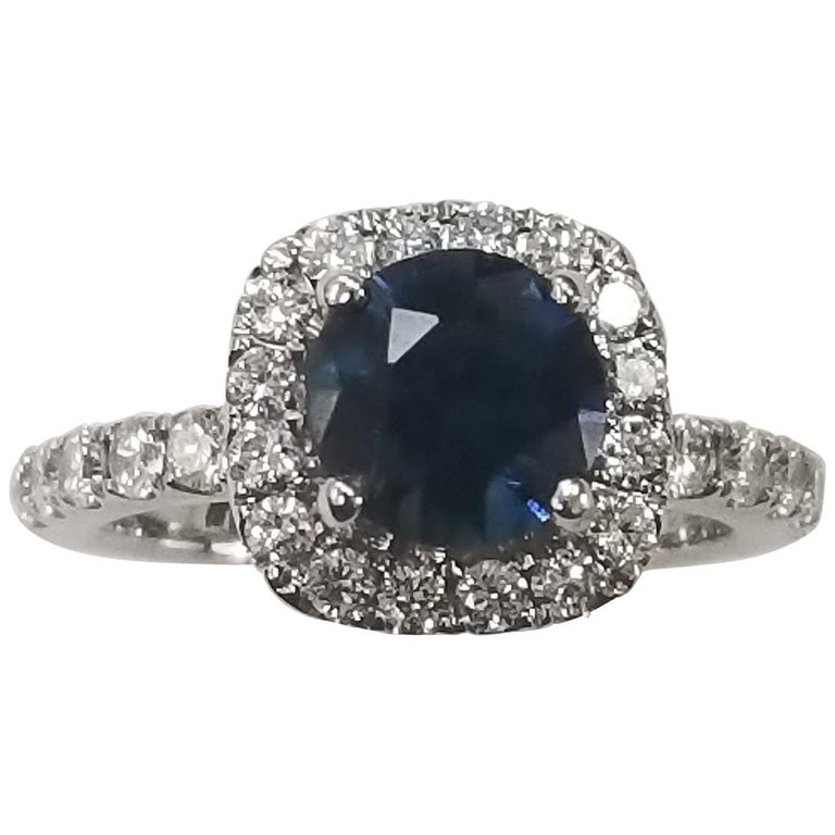 14 Karat White Gold Blue Sapphire and Diamond Halo Ring For Sale