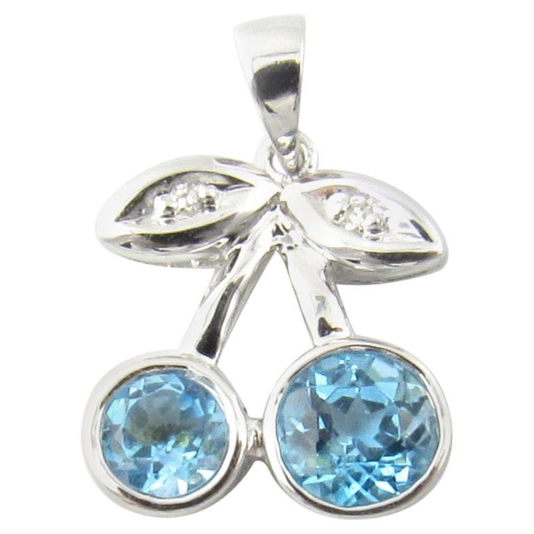 14 Karat White Gold Blue Topaz and Diamond Cherry Pendant