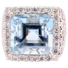 14 Karat White Gold Blue Topaz and Diamond Fashion Ring
