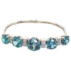 14 Karat White Gold Blue Zircon and Diamond Bracelet
