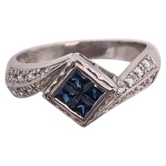 14 Karat White Gold Contemporary Center Sapphire Ring with Diamond Side Accents