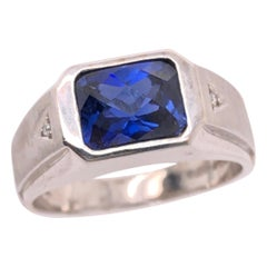 14 Karat White Gold Contemporary Sapphire Ring with Diamond Accents
