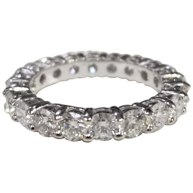 14 Karat White Gold Diamond 2.50 Carat Eternity Ring with Shared Prongs For Sale