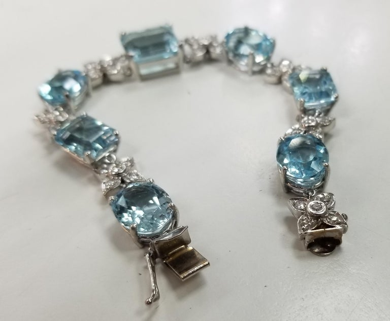 14 karat white gold Diamond and Blue Topaz bracelet, containing 35 round full cut diamonds; color
