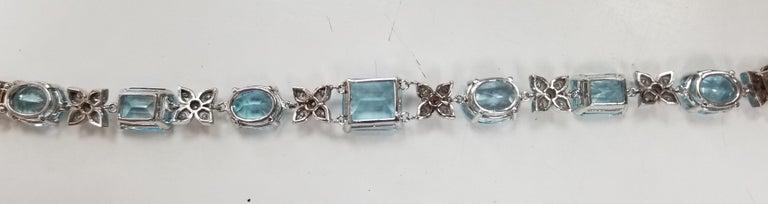 Artist 14 Karat White Gold Diamond and Blue Topaz Bracelet For Sale