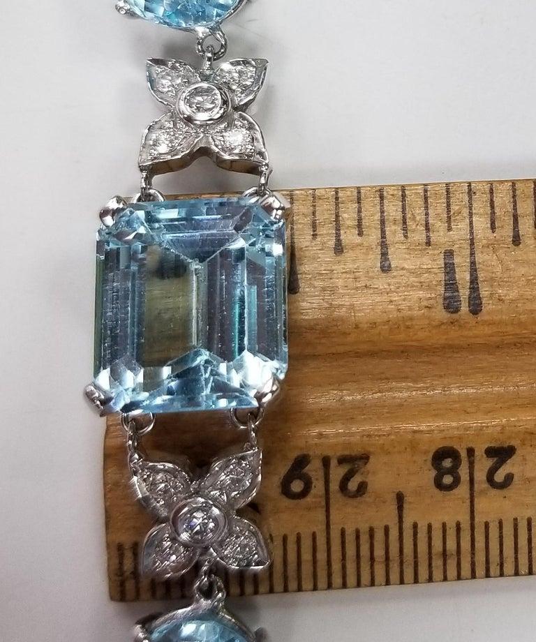Emerald Cut 14 Karat White Gold Diamond and Blue Topaz Bracelet For Sale