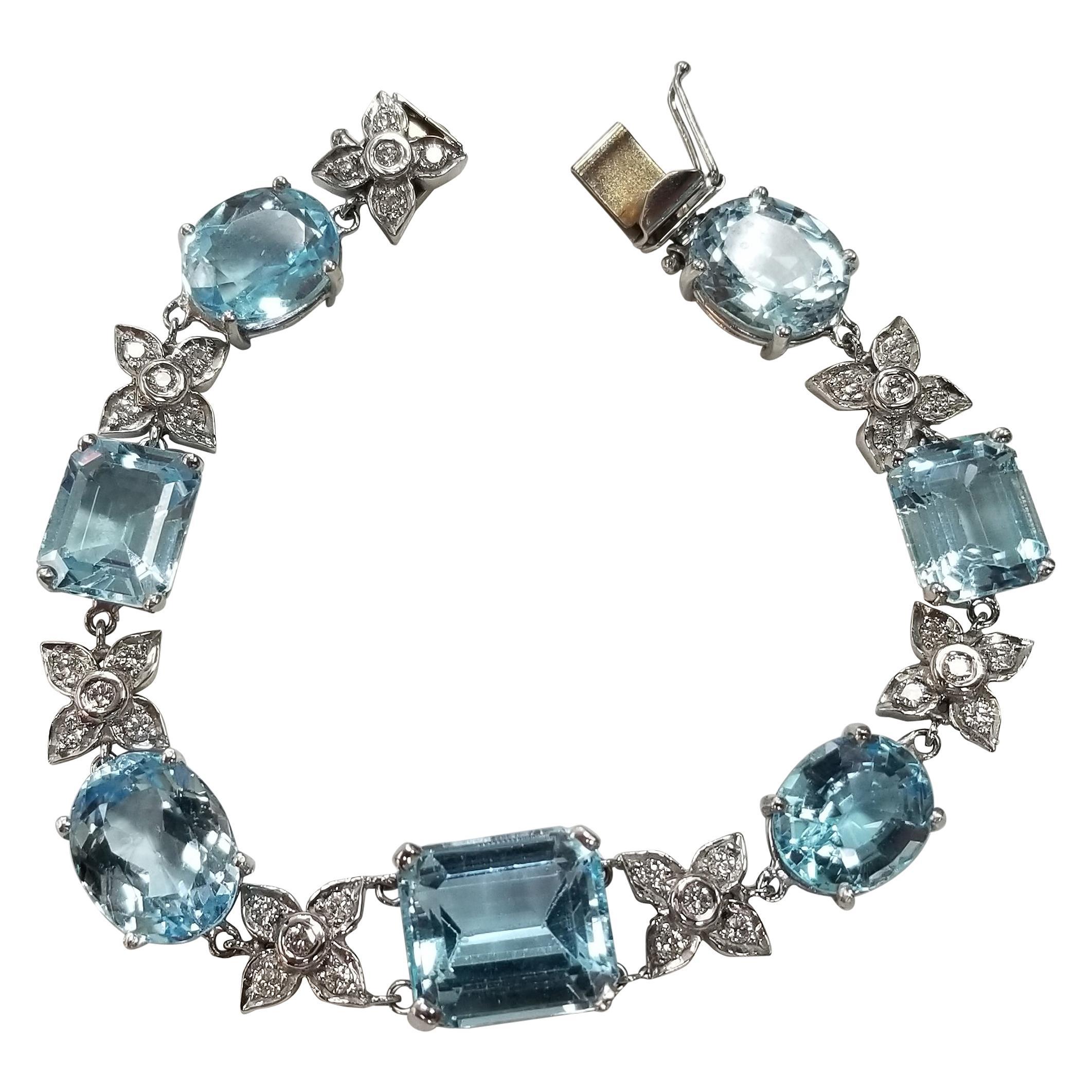 14 Karat White Gold Diamond and Blue Topaz Bracelet