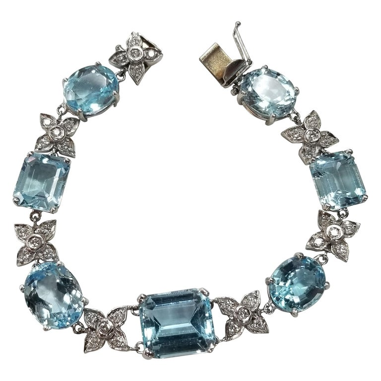 14 Karat White Gold Diamond and Blue Topaz Bracelet For Sale