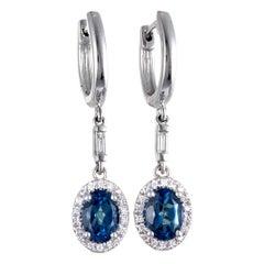 14 Karat White Gold Diamond and London Topaz Oval Dangle Snap Earrings