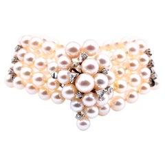 14 Karat White Gold Diamond and Pearl Four Strand Bracelet