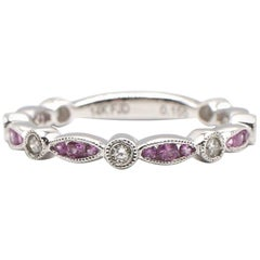 14 Karat White Gold Diamond and Pink Sapphire Band Ring Migraine Bezel Set
