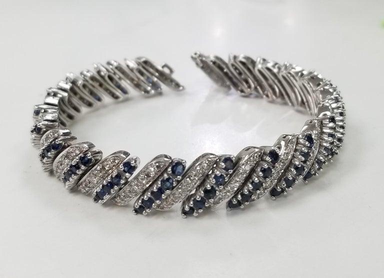14 karat white gold Diamond and Sapphire flexible bracelet, containing 147 round full cut diamonds; color