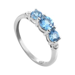 14 Karat White Gold Diamond and Topaz Band Ring
