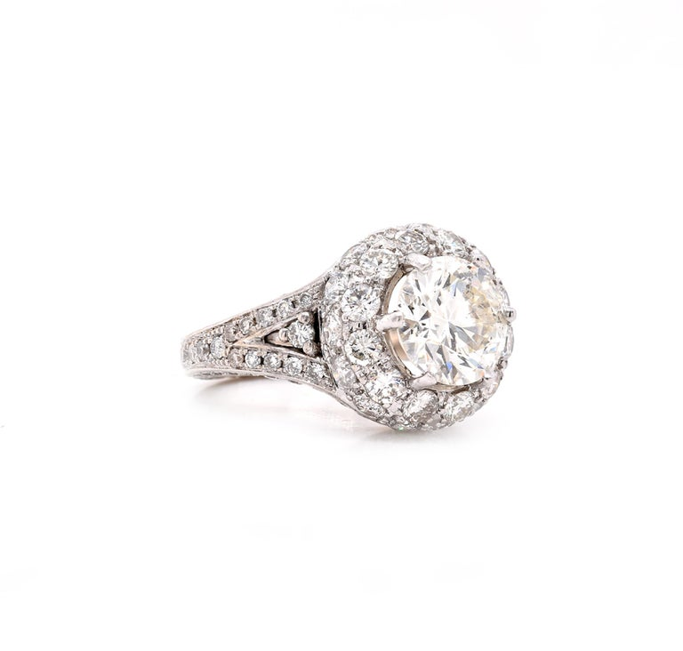Material: 14K white gold Center Diamond: 1 round brilliant cut = 2.16ct Color: J Clarity: I1 Diamonds: 140 round cut = 2.50cttw Color: G Clarity: SI Ring Size: 5 (please allow up to 2 additional business days for sizing requests) Dimensions: ring