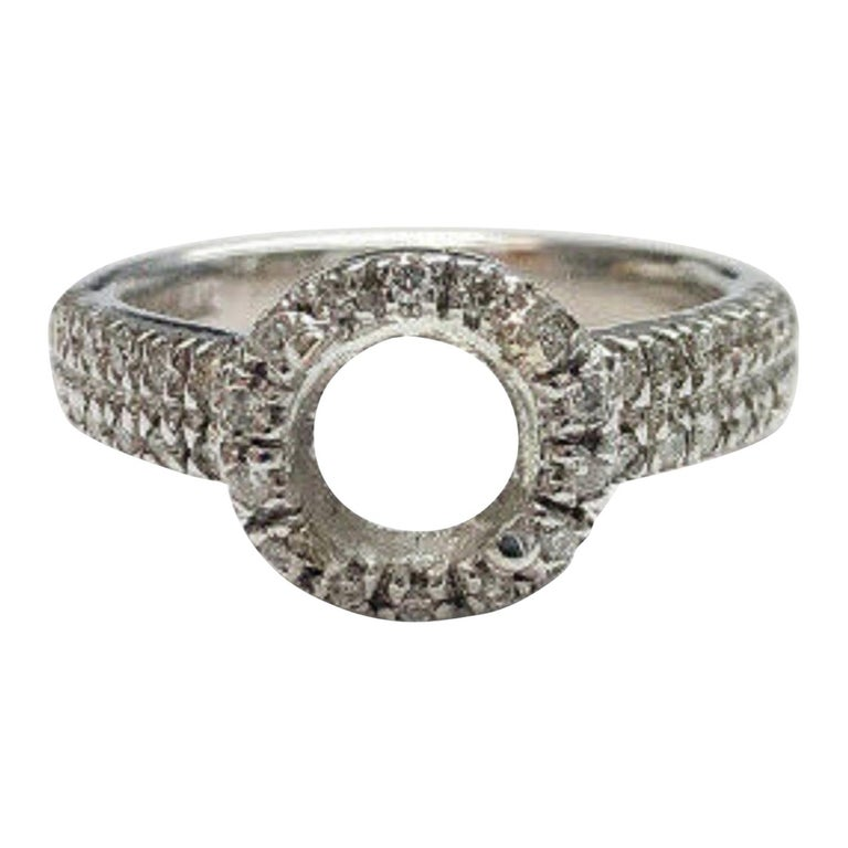 14 Karat White Gold Diamond Halo Ring For Sale